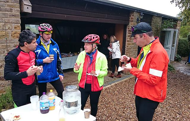 CTC Northampton cyclists enjoying coffee and cake outdoors at the renowned Great Brington pop-up cafe