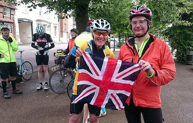 Cyclists from CTC Northampton and CTC Milton Keynes holding a Union Jackon at meetup in Buckingham - Guy Barber Memorial Ride 2017