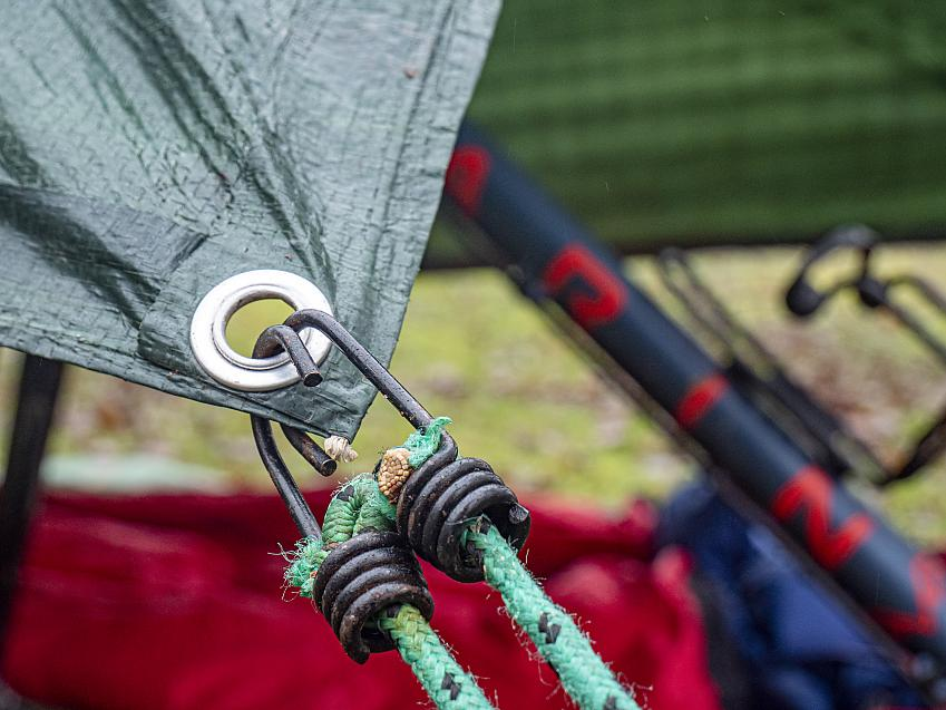 Bungee cords being used to tension a tarp.