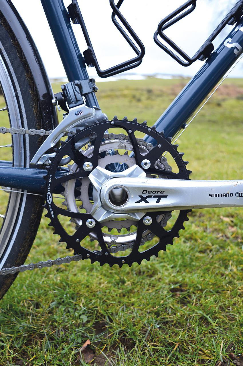 The 48-36-26 chainset provides better touring gears than a road triple