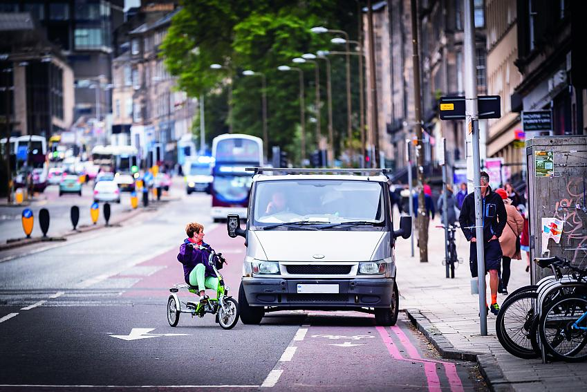 A cyclist moving around a van parked in a cycle lane