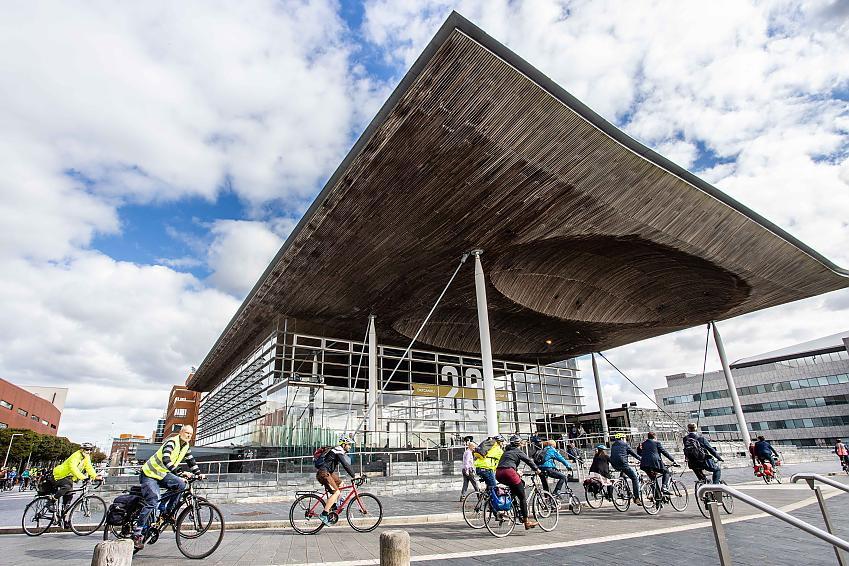 Group of people cycling through Cardiff to the Senedd