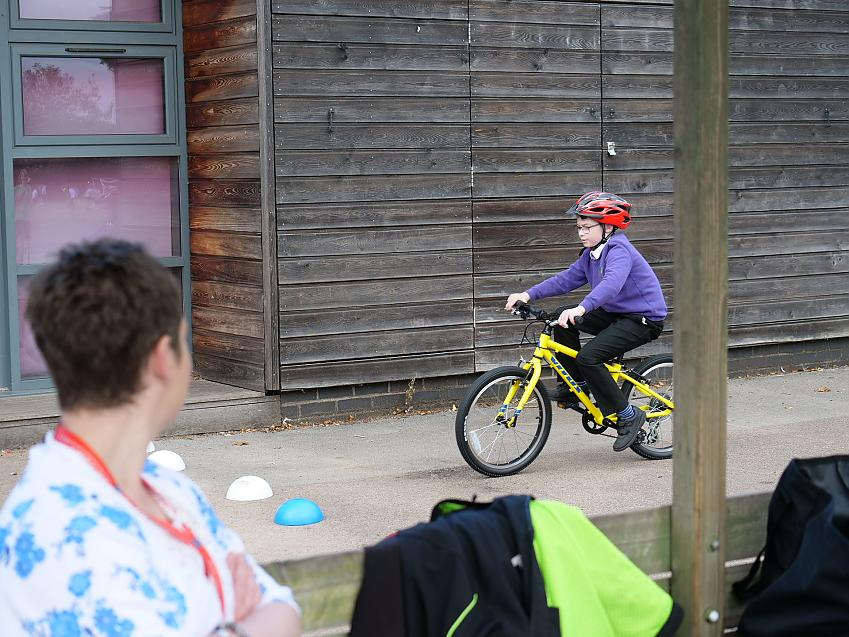 Declan's mum Siobhan watches as he takes his first solo ride