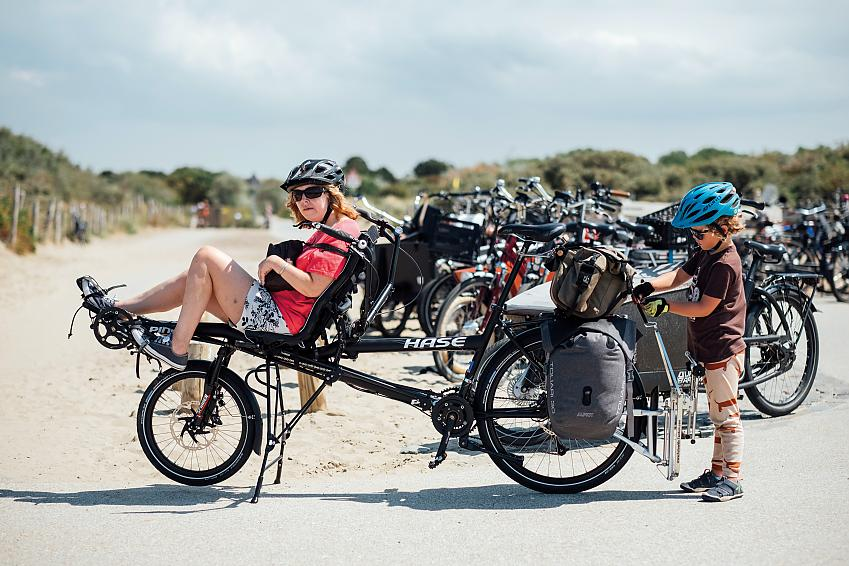 Tam on the front of a semi-recumbent Hase tandem