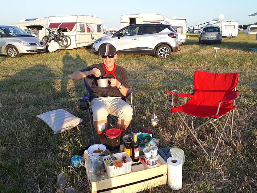 Makeshift dining table next to motorhomes