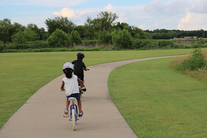 Children riding through the park