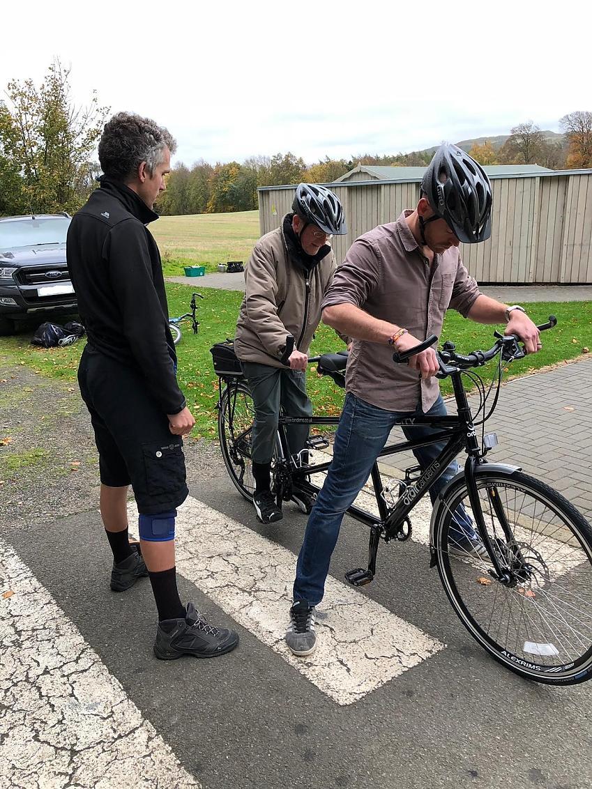 Cycling UK's David Glover helping Bryce get underway