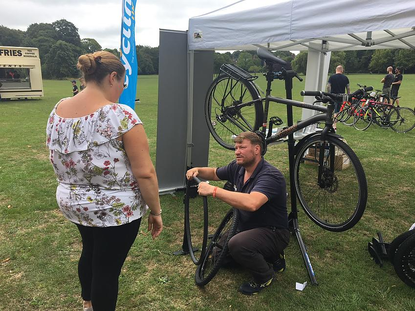 Cycling Development Officer Chris Alston demonstrates a puncture repair