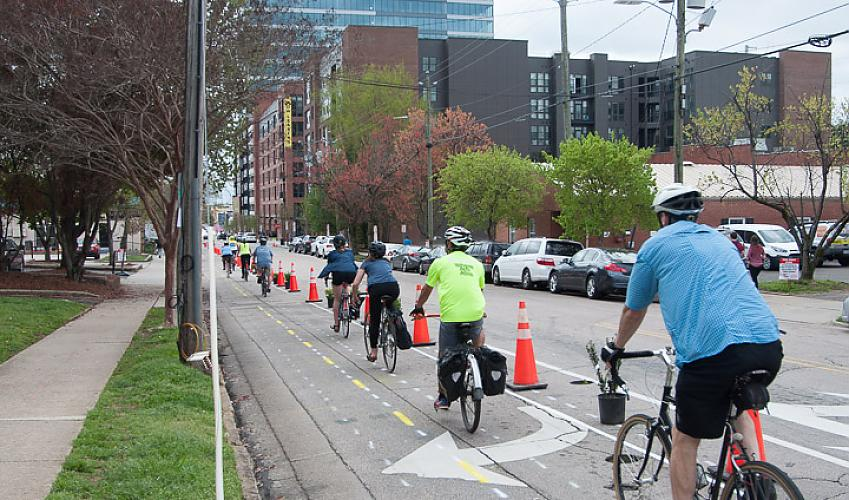 Traffic cones and planters can be used to quickly create temporary cycling and walking space. Image cc Leo Suarez.