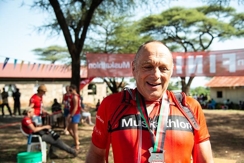 David completing charity ride in Kenya