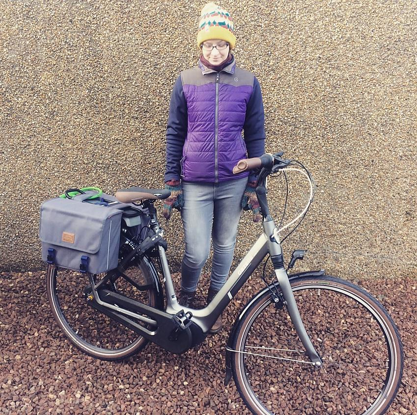 Claire gives her borrowed electric bike a loving look