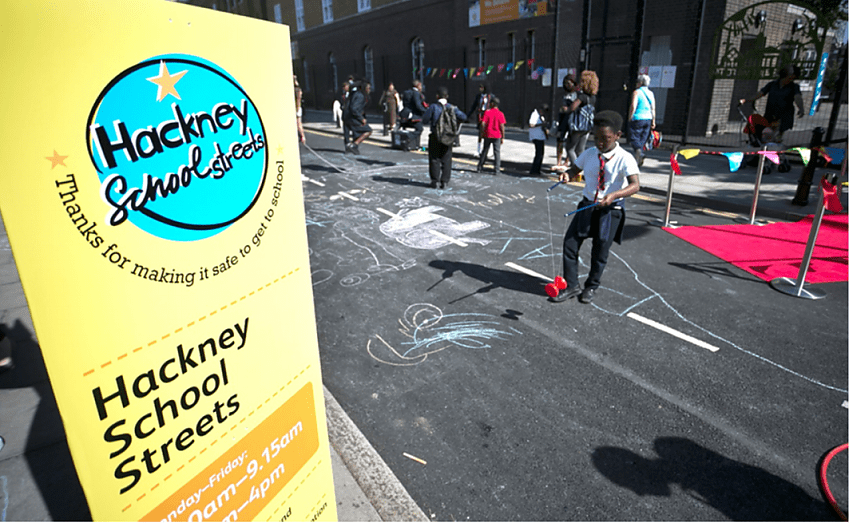Children play on traffic-free school street in Hackney London