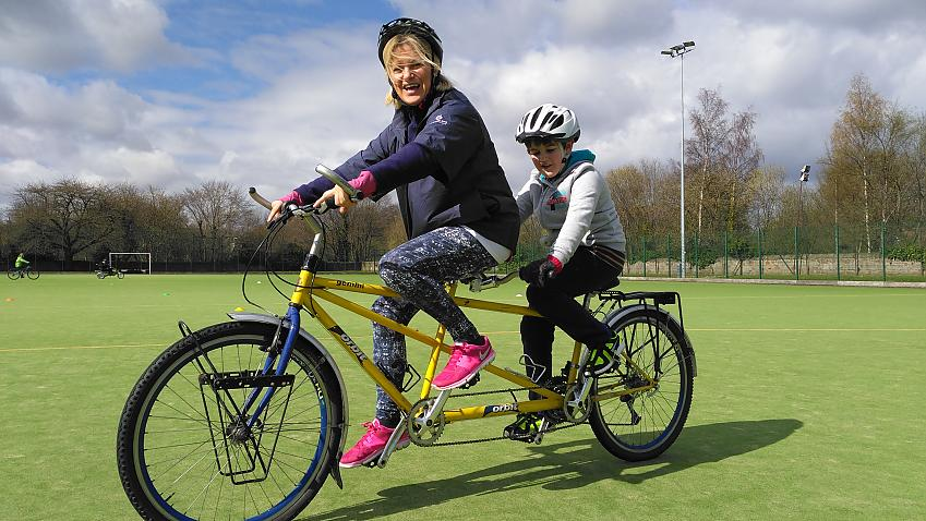 Women and boy on a tandem bike