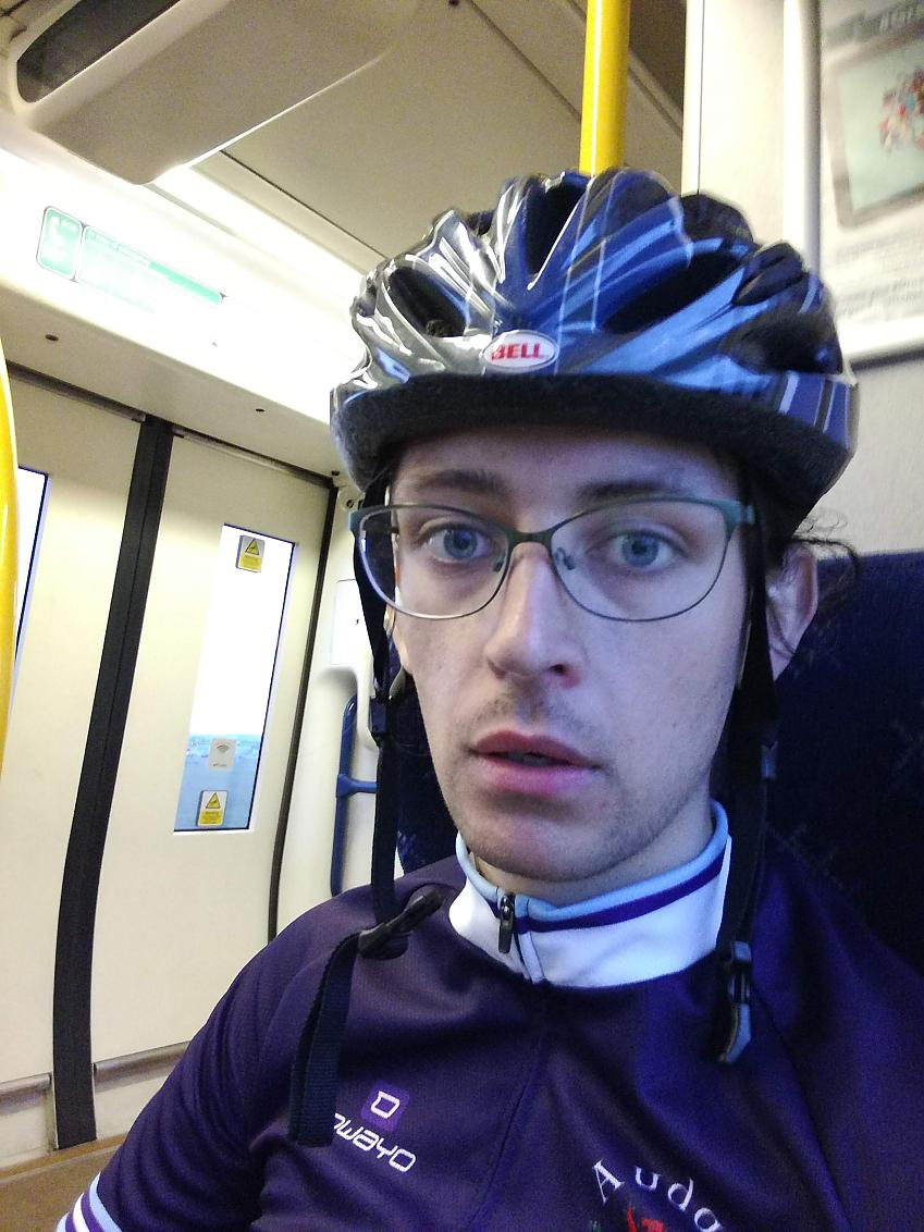 Esmond looking tired on a train after a long ride