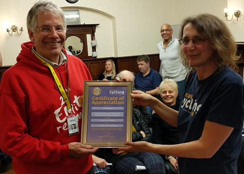 Jim Brown receives his Certificate of Appreciation from incoming Secretary Tina Walker  Photo by Cycling UK Stevenage