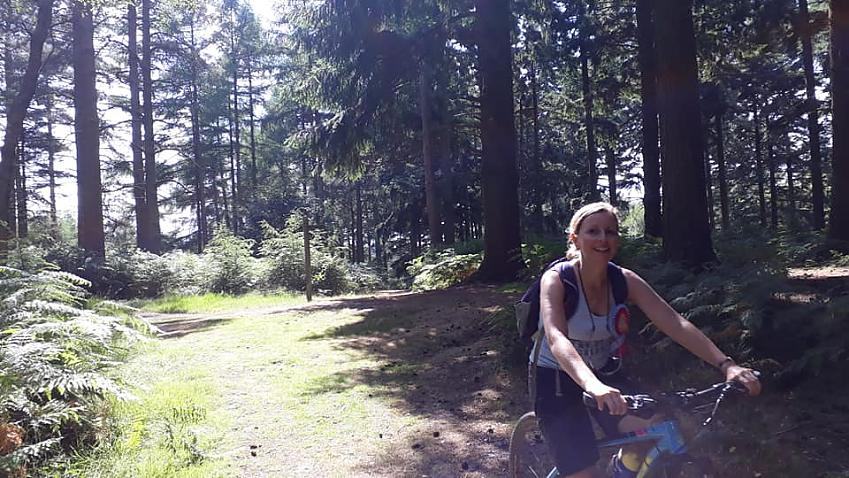 Laura riding through the woods above Holmwood
