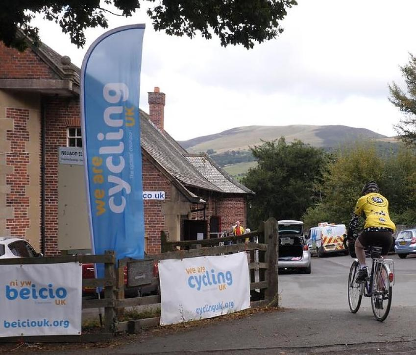 A rider arriving at the village hall for the buffet lunch.  Photo by Robby Spanring, Cycling UK