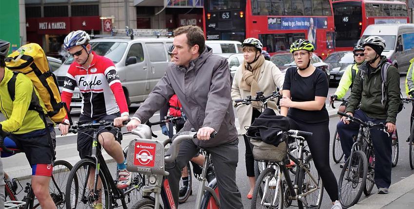 Cyclists waiting at traffic lights
