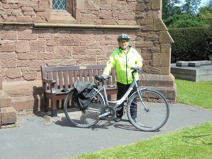 Sylvia with her bike 'Eti' at Capenhurst Church, Cheshire
