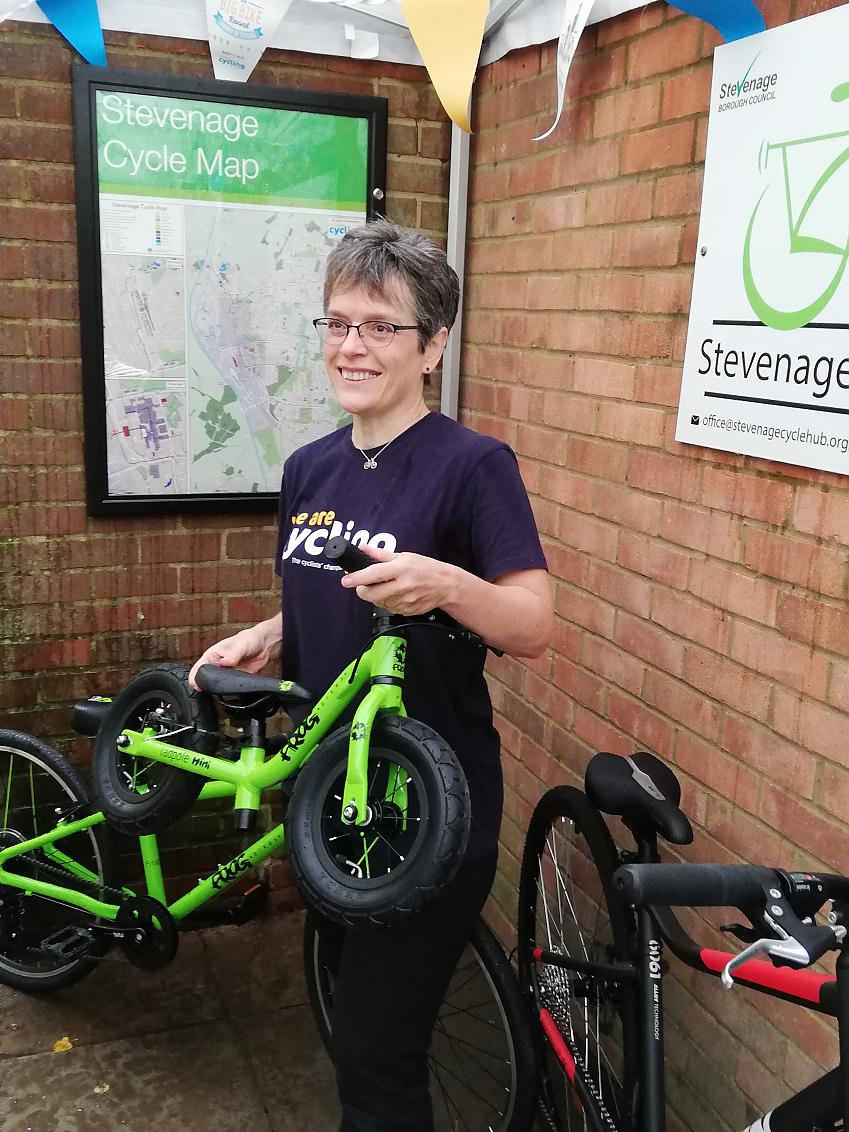 Jill Borcherds with the poster displayed on the wall of the Cycle Hub