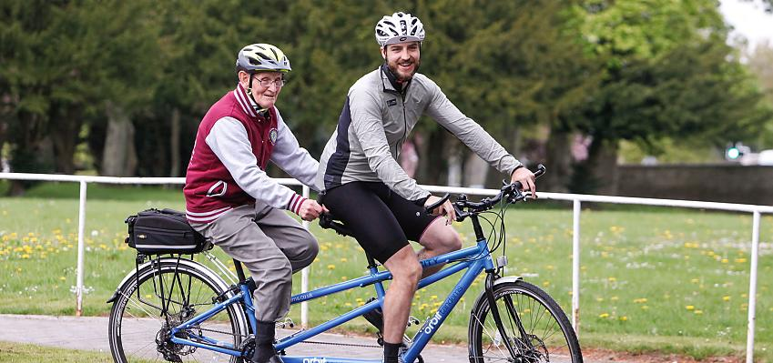 Two men riding a tandem
