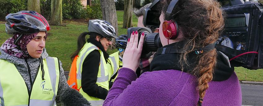TV news crew interviewing a cyclist