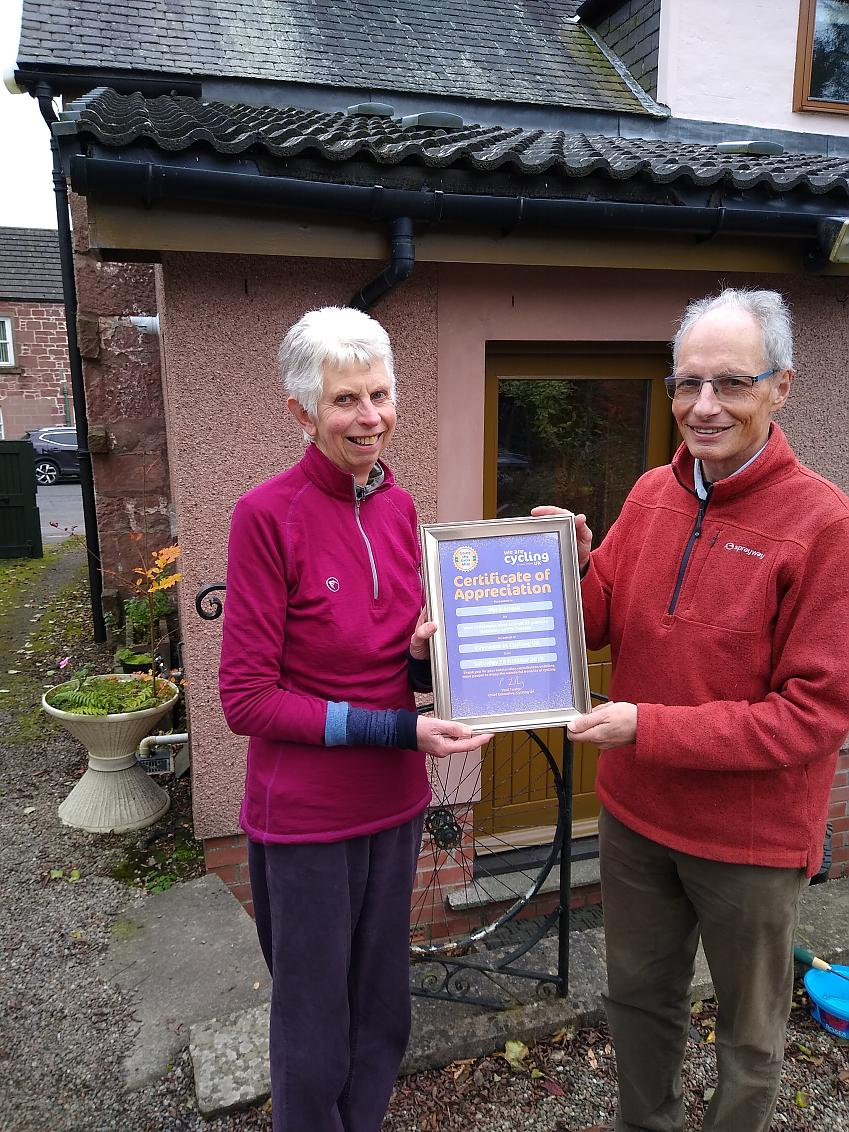 Pat Harrow receives a Certificate of Appreciation from David Ryder Photo CTC Tayside
