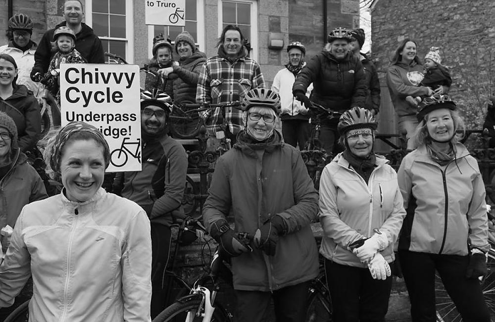 Group of cyclists holding placards