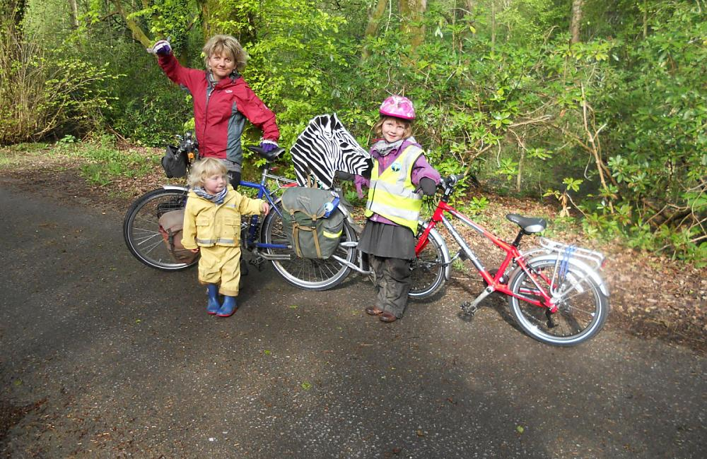 Josie Dew and family cycling to school