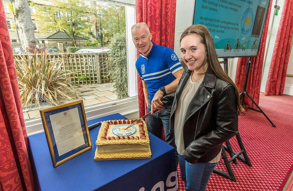 Paul Tuohy and Tourist competition junior winner Sophia Morris cut the birthday cake