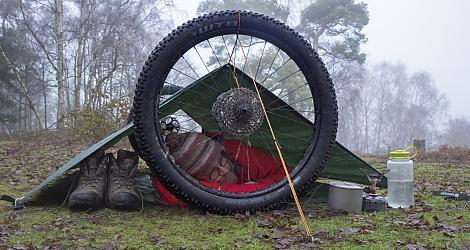 Bikepacker using his bike to create a shelter