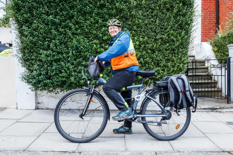 Woman cyclist on her bike