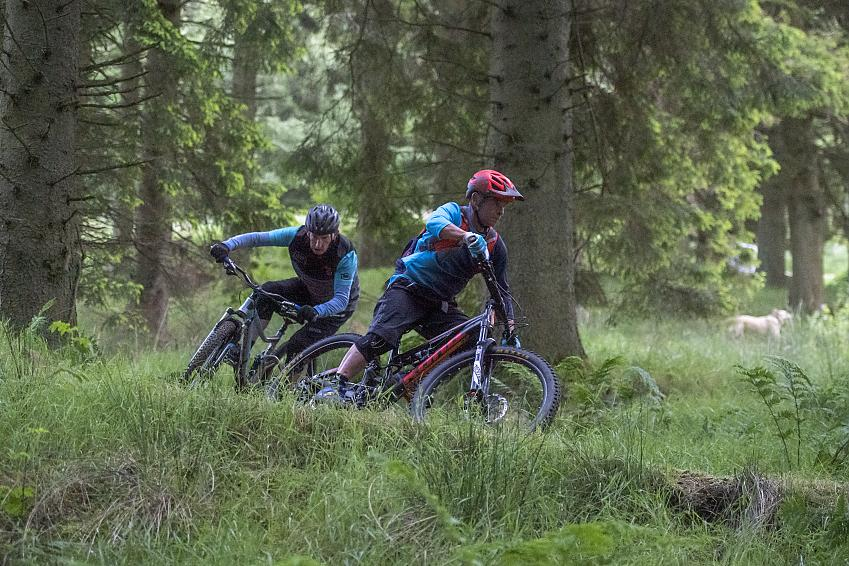 Two mountain bikers descending down the Bloody Bush MTB trail. Photo Joolze Dymond / Cycling UK
