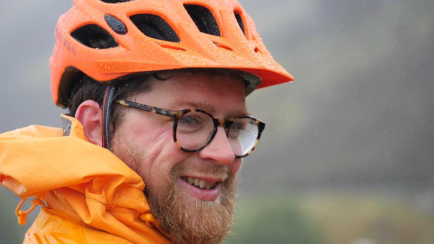 Cyclist grinning in the rain