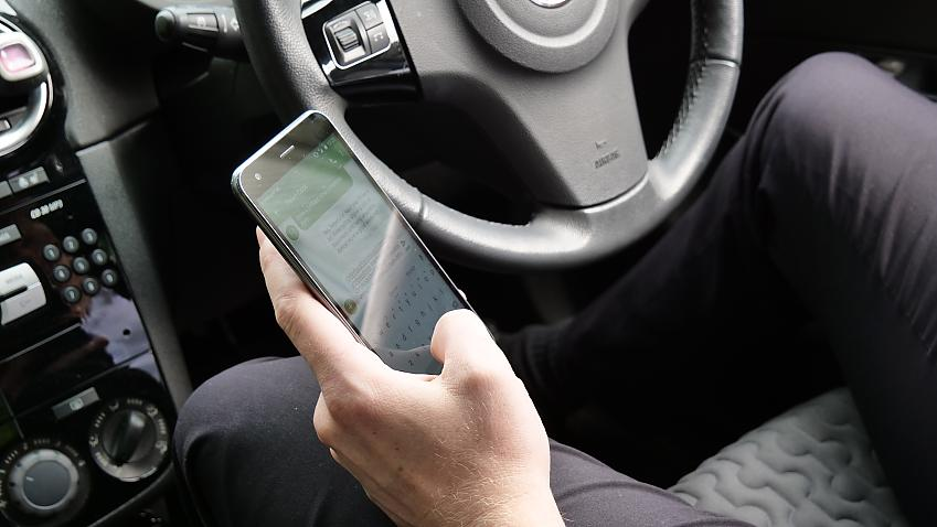 A driver using a mobile phone at the wheel