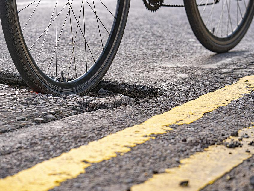 Potholes towards the side of the road put cyclists at particularly high risk