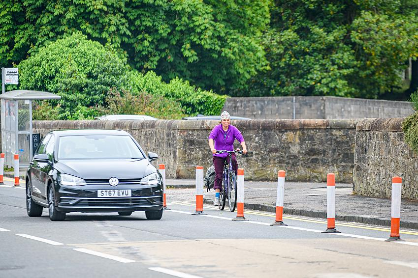 A woman cycling in a separated cycle lane