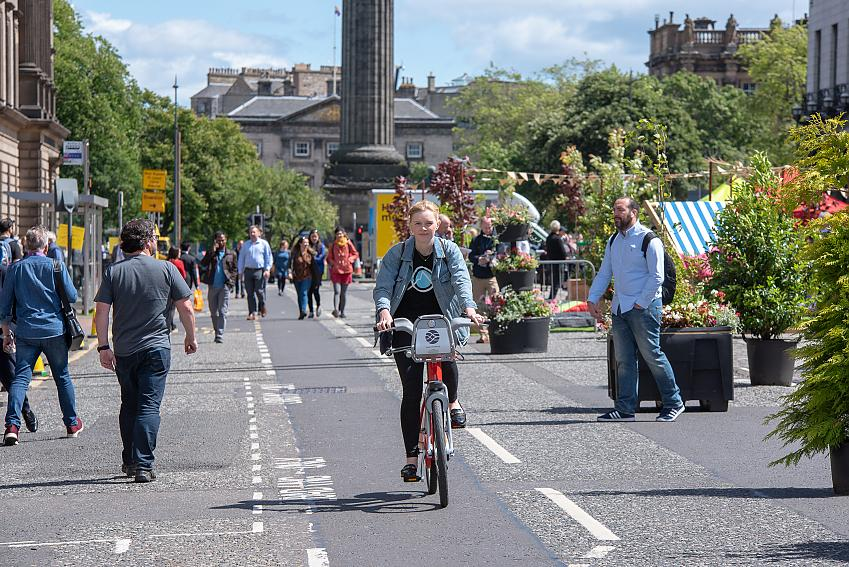 Woman cycling in Edinburgh, Scotland