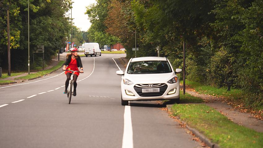 Cyclist swerves to avoid car parked in cycle lane