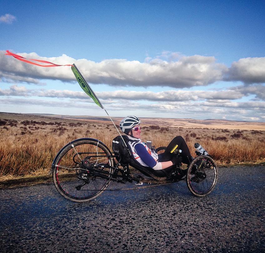 Natalie riding through Exmoor National Park