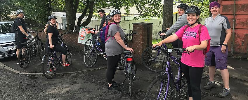 group of people standing with bikes
