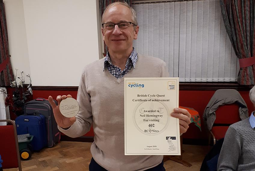 Neil receiving his award