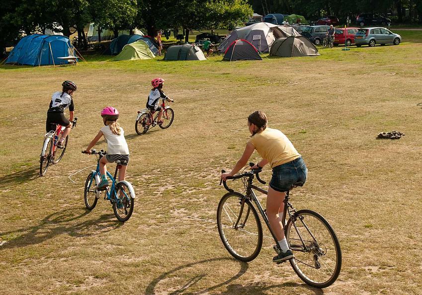 Several children on bikes