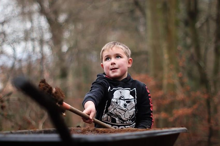 A young volunteer getting stuck in to the digging at BPB
