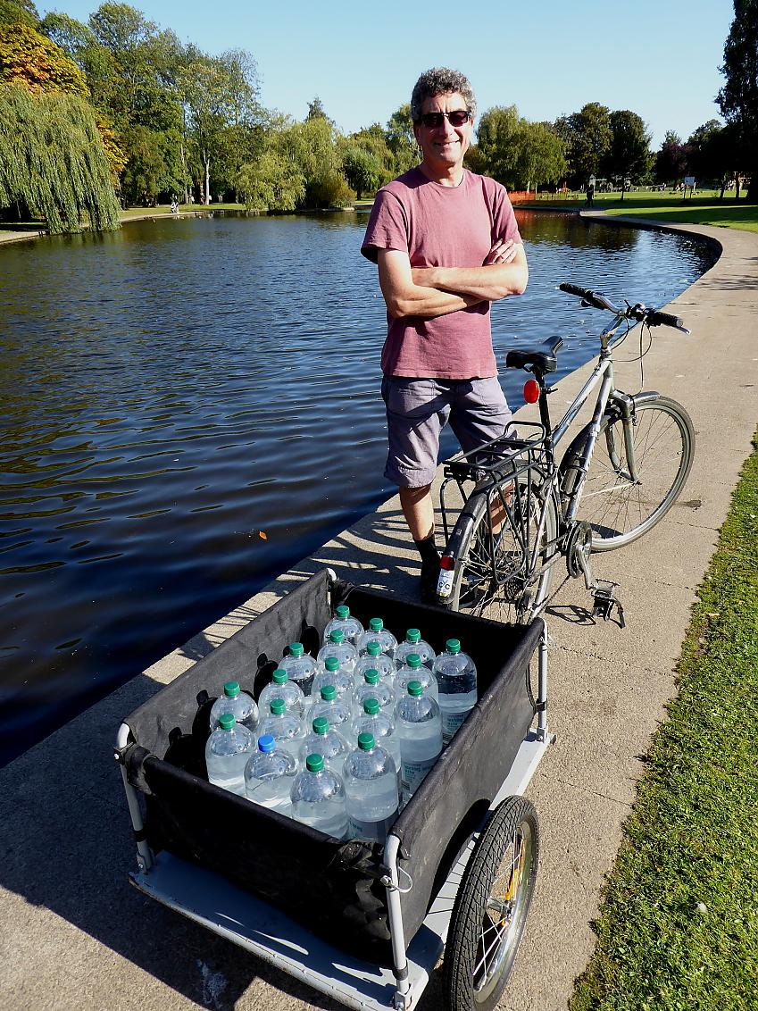 Rob Ainsley with a trailer full of water bottles