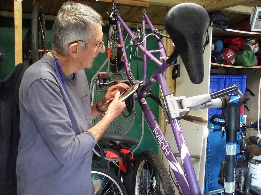 Davin Palmer fixing bikes for the community