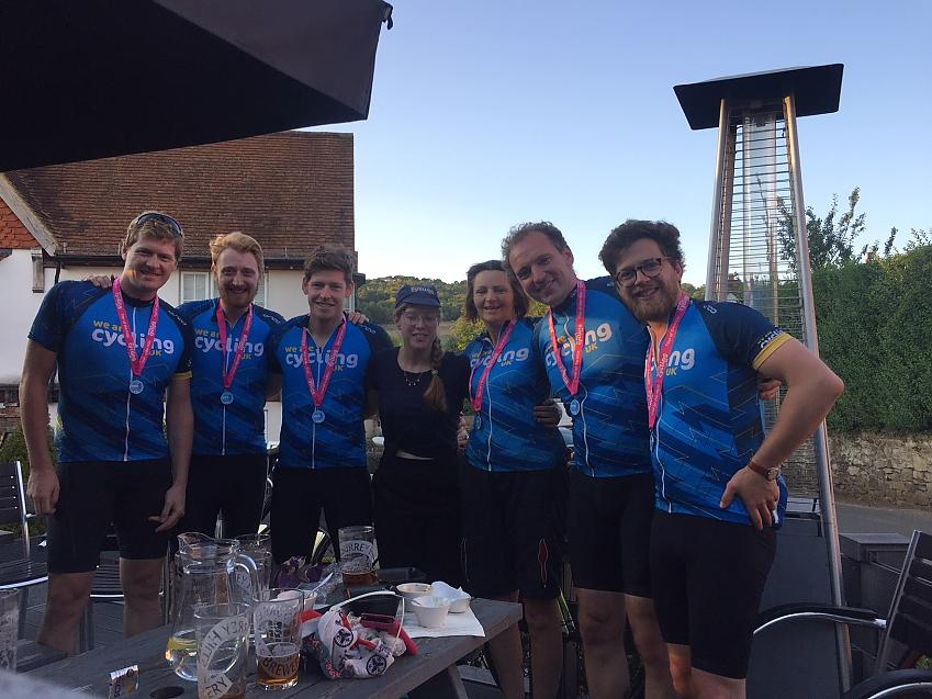 Team Cycling UK with beer and medals at the end of the Tour of the Hills