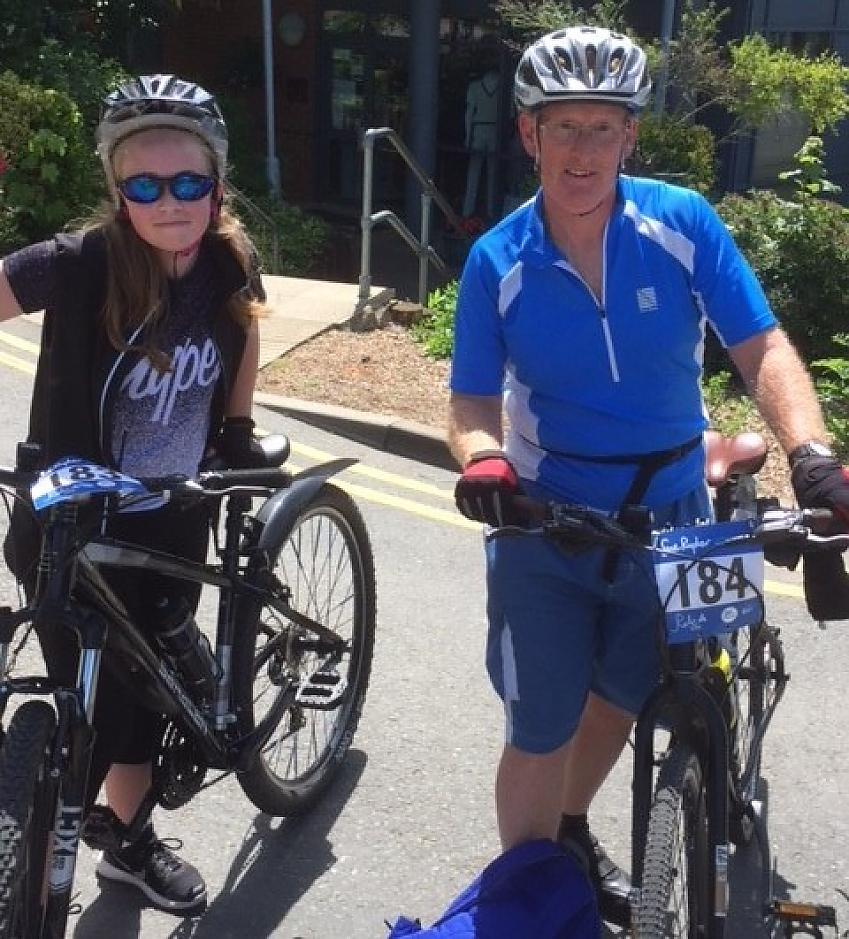 Ian and his daughter Charlotte taking on a charity bike ride
