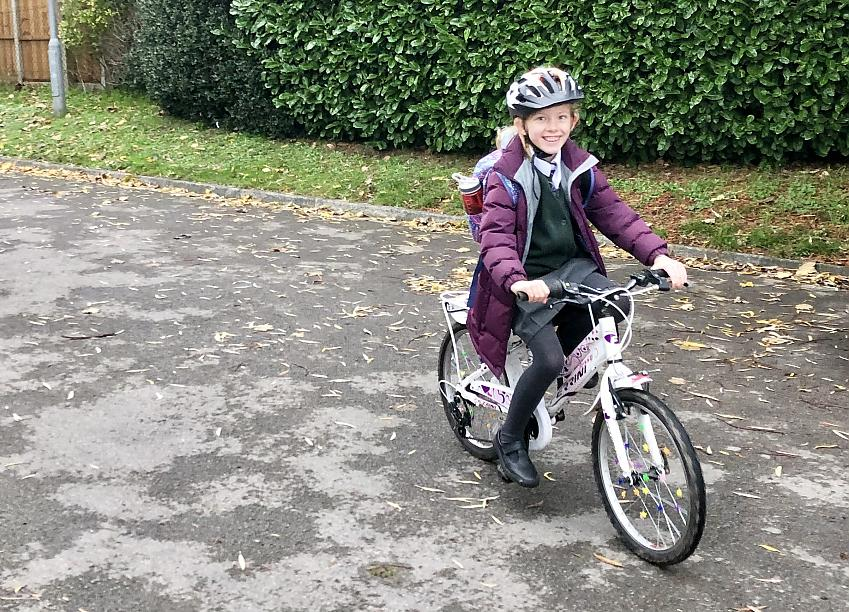 Isla riding to school with confidence after training