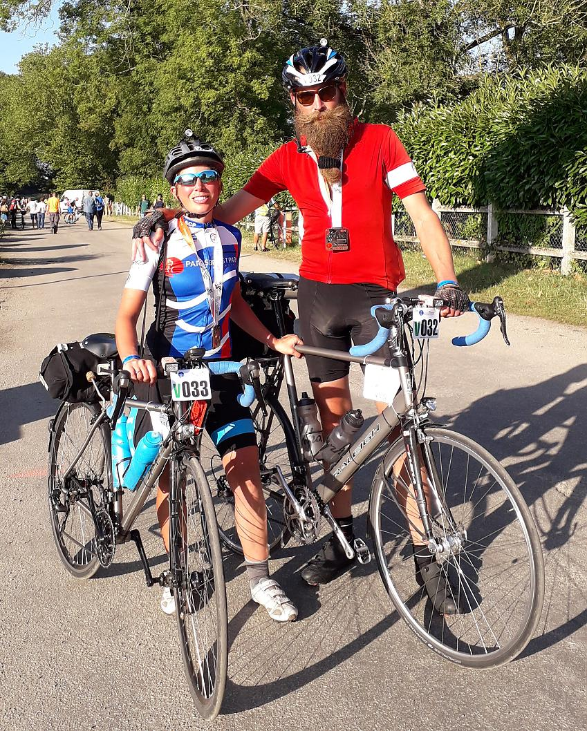 Laura and Stevie at the end of Paris-Brest-Paris, 2019. Laura on a Spa Audax titanium and Stevie on his hand-built Raleigh dynatec titanium